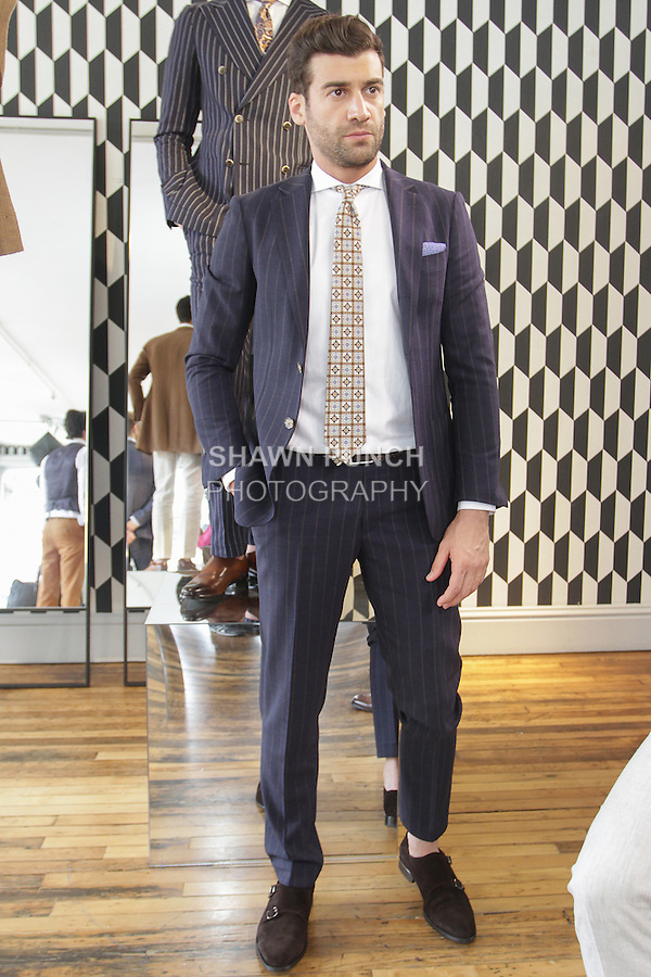 Model poses in an outfit from the Suit Supply Spring Summer 2016 collection, at 453 Broome Street, during New York Fashion Week Men's Spring Summer 2016.