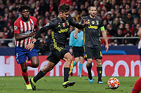 Atletico de Madrid's Thomas Teye and Juventus' Paulo Dybala during UEFA Champions League match, Round of 16, 1st leg between Atletico de Madrid and Juventus at Wanda Metropolitano Stadium in Madrid, Spain. February 20, 2019. (Insidefoto/ALTERPHOTOS/A. Perez Meca)<br /> ITALY ONLY