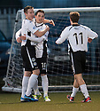 Queen of the South's Nicky Clark (centre) is congratulated by Kevin Holt (left) and Daniel Carmichael (11) after he scores their second goal.