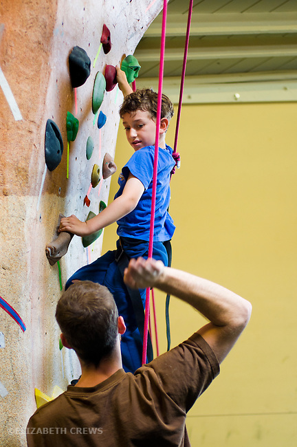 El Cerrito CA Boy, 6, getting climbing advice at indoor climbing gym MR