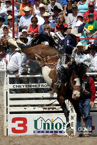 Cheyenne, Wyoming-7/26/2009-Photo by Rick Davis - PRCA cowboy Billy Etbauer of Edmond, Oklahoma, scored a crowd pleasing 89 point saddle bronc ride on the Harry Vold bronc Painted Valley during final round action at the 113th annual Cheyenne Frontier Days Rodeo. Billy's total score of 254 points on three broncs earned him the Cheyenne Saddle Bronc Championship, the one title which has eluded him during the course of his 21 year Professional Rode Cowboy Association career.