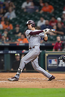 Tanner Poole (12) of the Mississippi State Bulldogs follows through on his swing against the Sam Houston State Bearkats in game eight of the 2018 Shriners Hospitals for Children College Classic at Minute Maid Park on March 3, 2018 in Houston, Texas.  The Bulldogs defeated the Bearkats 4-1.  (Brian Westerholt/Four Seam Images)