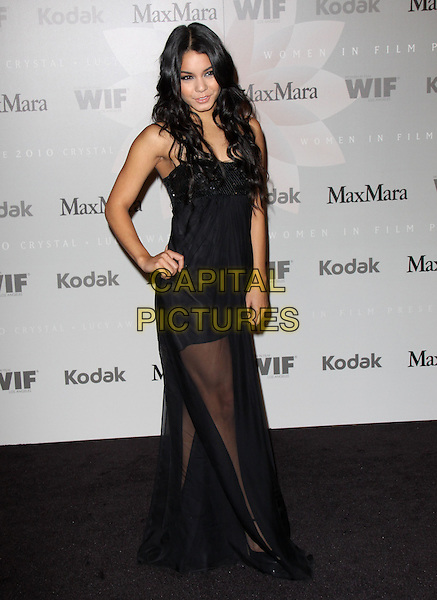 VANESSA HUDGENS.The 2010 Women in Film Crystal + Lucy Awards held at The  Hyatt Regency Century Plaza in Century City, California, USA..June 1st, 2010       .dress sheer hand on hip maxi black sequins sequined full length mini .CAP/RKE/DVS.©DVS/RockinExposures/Capital Pictures.