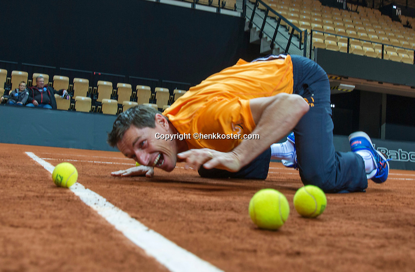 13 April, 2016, France, Trélazé, Arena Loire,   Semifinal FedCup, France-Netherlands, Dutch team warming up and are playing a game , captain Paul Haarhuis makes shure the ball is in.<br /> Photo:Tennisimages/Henk Koster