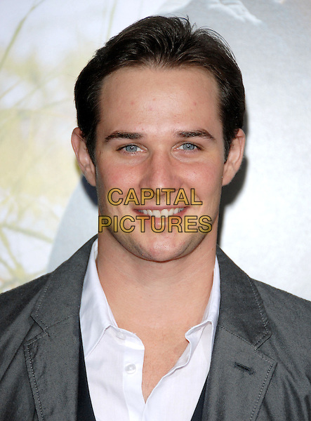 "RYAN MERRIMAN .at the Screen Gems' L.A. Premiere of ""Dear John"" held at The Grauman's Chinese Theatre in Hollywood, California, USA, February 1st 2010.   .arrivals portrait headshot grey gray white shirt smiling .CAP/RKE/DVS.©DVS/RockinExposures/Capital Pictures."