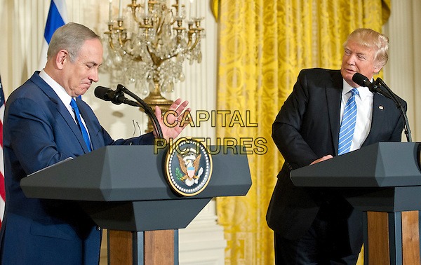 United States President Donald J. Trump, right, holds a joint press conference with Prime Minister Benjamin Netanyahu of Israel, left, in the East Room of the White House in Washington, DC on Wednesday, February 15, 2017.<br /> CAP/MPI/CNP/RS<br /> &copy;RS/CNP/MPI/Capital Pictures