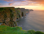 County Clare, Ireland                  <br /> Sunset light on the Cliffs of Moher - black shale and limestone 650 ft above the sea extending for five miles