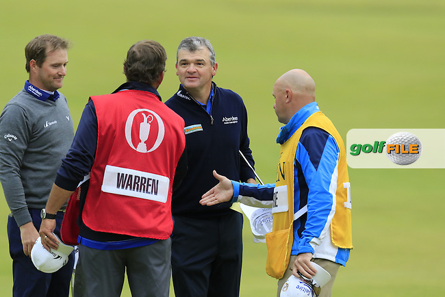 Paul LAWRIE (SCO) and Marc Warren (SCO) finish their match on the 18th green during Sunday's Round 3 of the 144th Open Championship, St Andrews Old Course, St Andrews, Fife, Scotland. 19/07/2015.<br /> Picture Eoin Clarke, www.golffile.ie