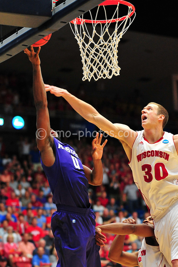 Mar 19, 2011; Tucson, AZ, USA; Wisconsin Badgers forward Jon Leuer (30) tries to block the shot of Kansas State Wildcats guard Jacob Pullen (0) in the second half of a game in the third round of the 2011 NCAA men's basketball tournament at the McKale Center.  The Badgers won 70-65.
