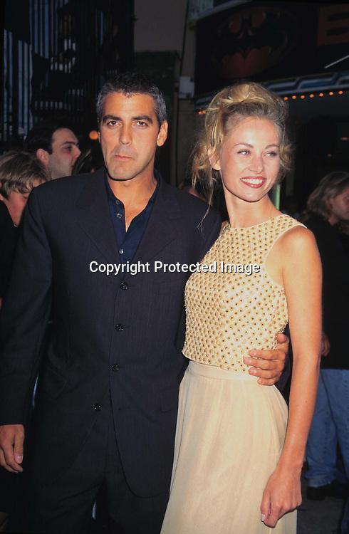 "©KATHY HUTCHINS/HUTCHINS.6/12/97 "" BATMAN & ROBIN"" PREMIERE.GEORGE CLOONEY & GIRLFRIEND CELINE"
