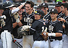 Trevor Fagan #20, Wantagh catcher, gets congratulated by teammates after connecting for a solo home run in the top of the fourth inning in Game 3 of the Nassau County varsity baseball Class A final against Garden City at SUNY Old Westbury on Tuesday, May 30, 2017.