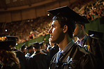Christopher Tomshack participates in spring undergraduate commencement. Photo by Ben Siegel