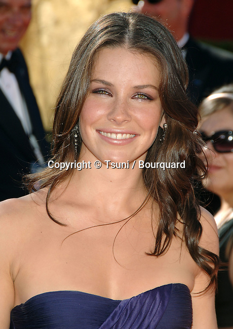 Evangelina Lilly arriving at the at the 58th Emmys Awards at The SHRINE AUDITORIUM  in Los Angeles. August 27, 2006.