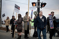 Ron Paul supporters stand on a street corner in Manchester, New Hampshire, on Jan. 7, 2012.  Paul is seeking the 2012 Republican presidential nomination.