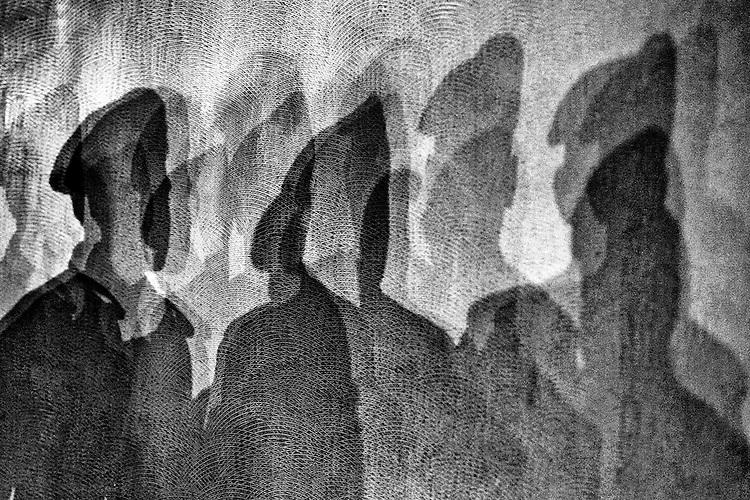 Shadows of Bangladesh Rapid Action Battalion personnel.