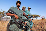 Anti-poaching unit on patrol in the bush, l-r Mshiyeni Ntuli, Sibusiso Mdluli, Sibongiseni Kunene, Ezemvelo KZN Wildlife, iMfolozi game reserve, KwaZulu-Natal, South Africa, June 2012