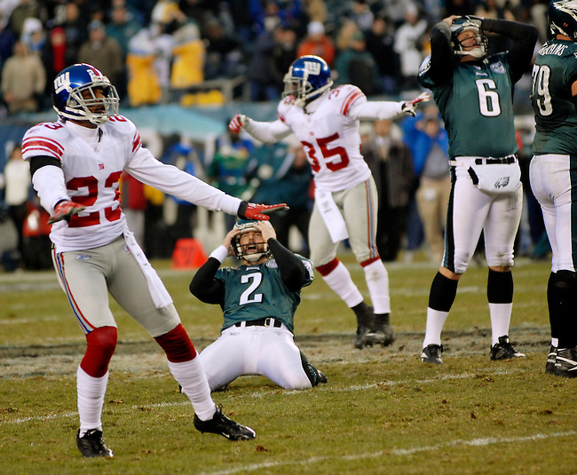 New York Giants defensive back Corey Webster (23) and teammate Kevin Dockery (35) react as the 57 yard field goal attempt by Philadelphia Eagles kicker David Akers (2)  hit the goalpost for no score in the final seconds of the fourth quarter NFL game Sunday. Dec. 9, 2007 in Philadelphia, Pa. Eagles extrapoint holder Sav Rocca (6) is at right. (Bloomberg News/Bradley C Bower)