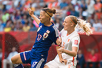 June 23, 2015: Yuki OGIMI of Japan and Stefanie VAN DER GRAGT of Netherlands fight for the ball during a round of 16 match between Japan and Netherlands at the FIFA Women's World Cup Canada 2015 at BC Place Stadium on 23 June 2015 in Vancouver, Canada. Japan won 2-1. Sydney Low/AsteriskImages.com