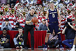 RALEIGH, NC - FEBRUARY 03: Referee Jerry Heater hands the ball to Notre Dame's Rex Pflueger (0). The North Carolina State Wolfpack hosted the University of Notre Dame Fighting Irish on February 3, 2018 at PNC Arena in Raleigh, NC in a Division I men's college basketball game. NC State won the game 76-58.