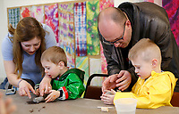 NWA Democrat-Gazette/DAVID GOTTSCHALK Sandra and Zach Cole help their sons Rowan (left), 2, and Grayson, a kindergarten student, Thursday, March 29, 2018, make a pinch pot inside the Art Lab at Terra Studios. The family was participating in a AR Connections Academy field trip at the studios that included a tour of the gallery, the Blue Bird making studio and the making of the pinch pot.