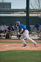 Chicago Cubs catcher Tyler Payne (7) starts down the first base line during a Minor League Spring Training game against the Oakland Athletics at Sloan Park on March 13, 2018 in Mesa, Arizona. (Zachary Lucy/Four Seam Images)