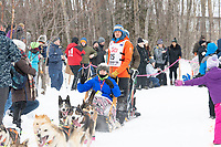 Joar Leifseth Ulsom and team run past spectators on the bike/ski trail near University Lake with an Iditarider in the basket and a handler during the Anchorage, Alaska ceremonial start on Saturday, March 7 during the 2020 Iditarod race. Photo © 2020 by Ed Bennett/Bennett Images LLC
