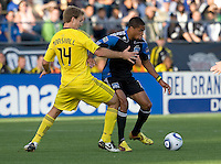 Ryan Johnson of Earthquakes dribbles the ball away from Chad Marshall of the Crew during the game at Buck Shaw Stadium in Santa Clara, California on June 2nd, 2010.  San Jose Earthquakes tied Columbus Crew, 2-2.