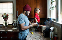 Olympic Gold champion wrestler Jordan Burroughs (cq), with his son Beacon Burroughs (cq, age 19 months) at home in Lincoln, Nebraska, Friday, February 12, 2015. Burroughs is training for the upcoming 2016 olympic games in Rio de Janeiro, Brazil where he hopes to win another gold medal. <br /> <br /> Photo by Matt Nager