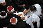 Druze Sheikhs collect leaflets at the end of a rally supporting Syrian president Assad, held by Druze in Majdal Shams, Golan Heights.