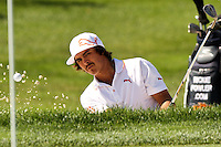 Rickie Fowler chipped his ball out of the bunker and onto the 17th green at the 5th Annual Notah Begay III Foundation Challenge at Atunyote Golf Club in Vernon, New York on August 29, 2012