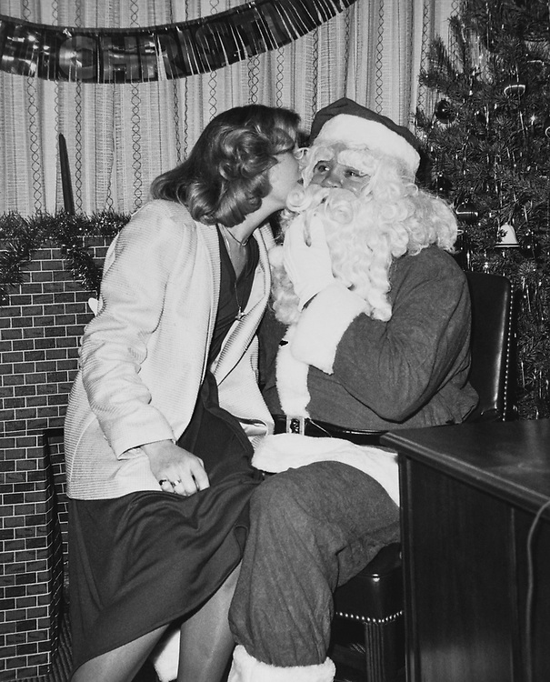 Staff member kissing Santa Claus during Christmas in 1979. (Photo by Dev O'Neill/CQ Roll Call via Getty Images)