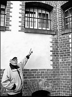 BNPS.co.uk (01202 558833)<br /> Pic: TheHistoryPress/BNPS<br /> <br /> Douglas Boyd in 2008 pointing to the window of his cell.<br /> <br /> A former spy has given a unique account of being held hostage in an East German prison and interrogated by the KGB in a new book.<br /> <br /> Ex-British agent Douglas Boyd was confronted by the KGB while enduring solitary confinement as a Cold War prisoner in a Stasi interrogation prison behind the iron curtain in 1959.<br /> <br /> KGB officers tried desperately to get him to break his cover - of a run of the mill clerk - and offered him a bogus deal in order to get him out of the prison so they could take him to a Gulag.<br /> <br /> The Solitary Spy, A Political Prisoner in Cold War Berlin, by Douglas Boyd, is published by The History Press and costs &pound;20.