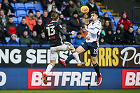 Bolton Wanderers' Tyler Walker beats Fulham's Tim Ream in the air<br /> <br /> Photographer Andrew Kearns/CameraSport<br /> <br /> The EFL Sky Bet Championship - Bolton Wanderers v Fulham - Saturday 10th February 2018 - Macron Stadium - Bolton<br /> <br /> World Copyright &copy; 2018 CameraSport. All rights reserved. 43 Linden Ave. Countesthorpe. Leicester. England. LE8 5PG - Tel: +44 (0) 116 277 4147 - admin@camerasport.com - www.camerasport.com