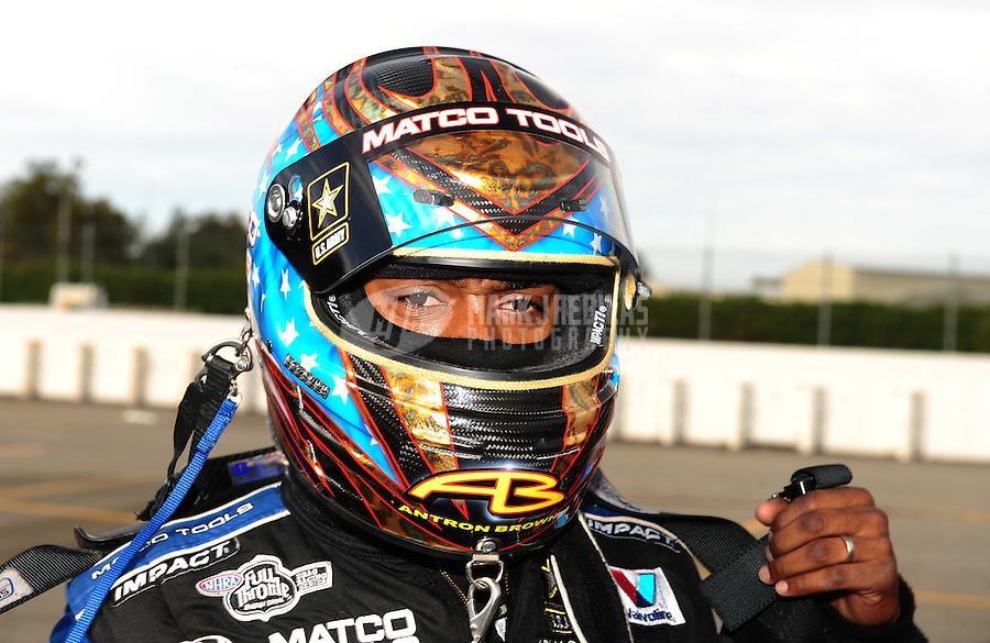 Nov. 13, 2011; Pomona, CA, USA; NHRA top fuel dragster driver Antron Brown during the Auto Club Finals at Auto Club Raceway at Pomona. Mandatory Credit: Mark J. Rebilas-.