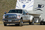 2011 Ford Super Duty towing fifth wheel trailer.