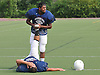 Anas Abbas, top, helps teammate Jeremy Elkashash stretch during New Hyde Park varsity football team practice at Tully Park on Monday, August 24, 2015.<br /> <br /> James Escher