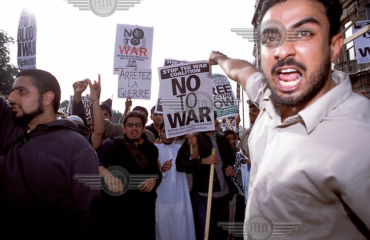© Marcus Rose / Panos Pictures..London, England, UK. 04/2002..British Muslims, Socialists and others in the crowd at an anti-war demonstration during the conflict in Afghanistan, heightened tensions between the West and Iraq, and Israeli military incursions into the West Bank.