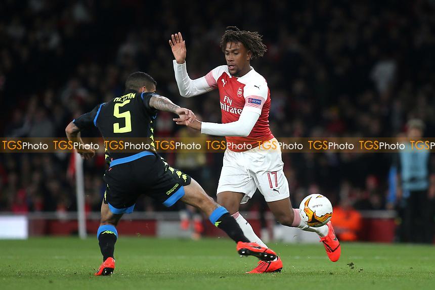 Alex Iwobi of Arsenal slips the ball past Napoli's Allan during Arsenal vs Napoli, UEFA Europa League Football at the Emirates Stadium on 11th April 2019