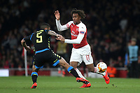 Alex Iwobi of Arsenal slips the ball past Napoli's Allan during Arsenal vs Napoli, UEFA Europa League Football at the Emirates Stadium on 11th April 2019