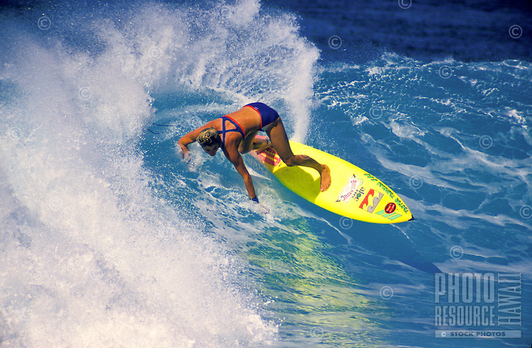 Jodi Cooper surfing  at Rocky point on the north shore of Oahu
