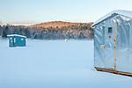 Ice fishing shacks on the Ottaquechee River in Quechee village, Hartford, VT, USA