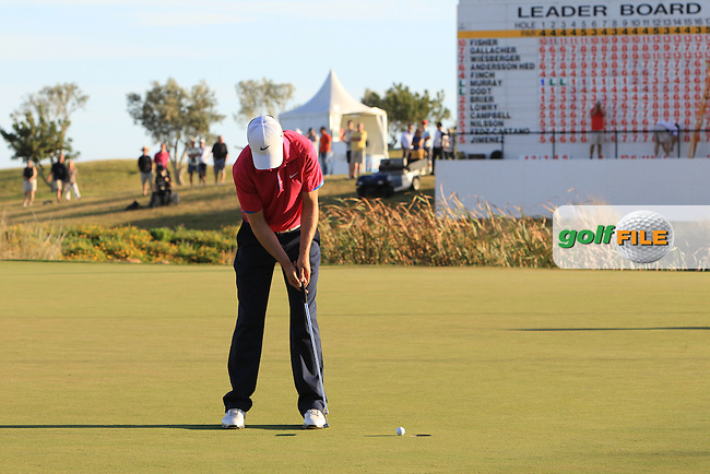 Ross Fisher (ENG) putts on the 18th green during Saturday's Round 3 of the Portugal Masters at the Oceanico Victoria Golf Course, Vilamoura, Portugal 13th October 2012 (Photo Eoin Clarke/www.golffile.ie)