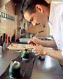 FRANCE, Burgundy, chef preparing food in restaurant, Le Charlemagne