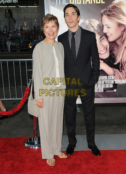 JUSTIN LONG & his mother .at the Warner Bros. Pictures' L.A. Premiere of 'Going the Distance' held at The Grauman's Chinese Theatre in Hollywood, California, USA, .August 23rd 2010..full length mum mom family  black suit tie checked check shirt  brown                                .CAP/RKE/DVS.©DVS/RockinExposures/Capital Pictures.