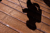 Shadow of an old woman using a walking cane on a wicker ramp, put up to avoid slippery steps in snowy weather, at the entrance to Togan-ji shrine in Sugamo, Tokyo, Japan. Monday February 4th 2008. Sugamo is affectionately known as the old lady Harajuku, in reference to the Mecca for youth fashions in the South of Tokyo, and is a popular place for Tokyo's increasingly aged population.