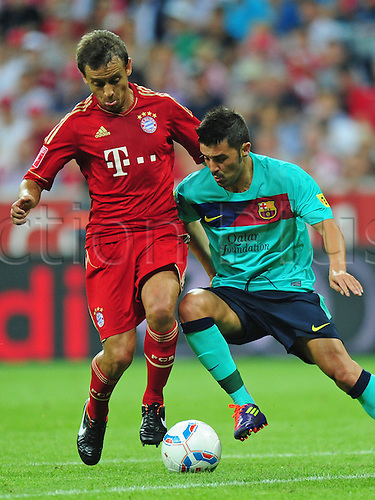 27.07.2011 Bayern's Rafinha (L) and Barcelona's David Villa vie for the ball during the Audi Cup final soccer match between FC Bayern Munich and FC Barcelona at the Allianz-Arena in Munich, Germany.