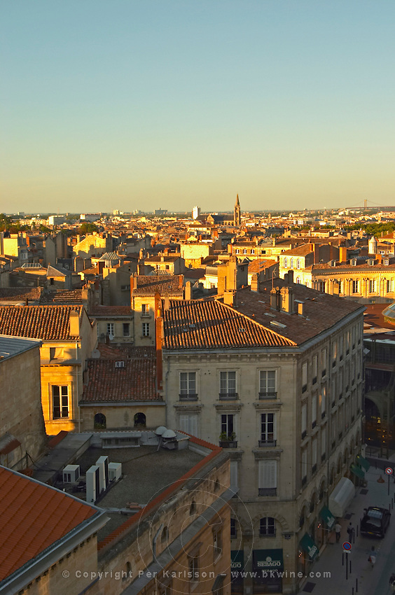 View over the city and roof tops in Bordeaux at sunset