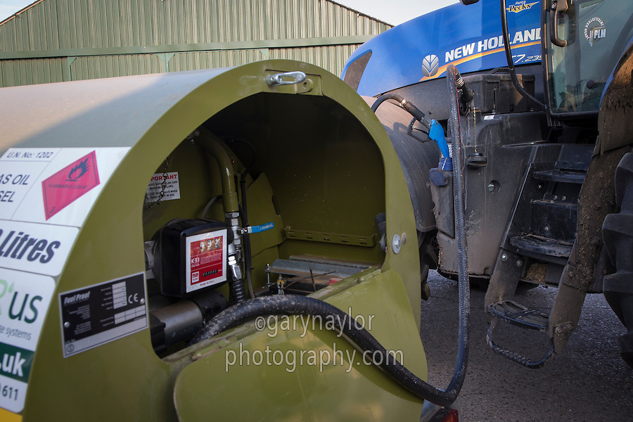Filling a tractor with diesel and AdBlue diesel emmissions additive