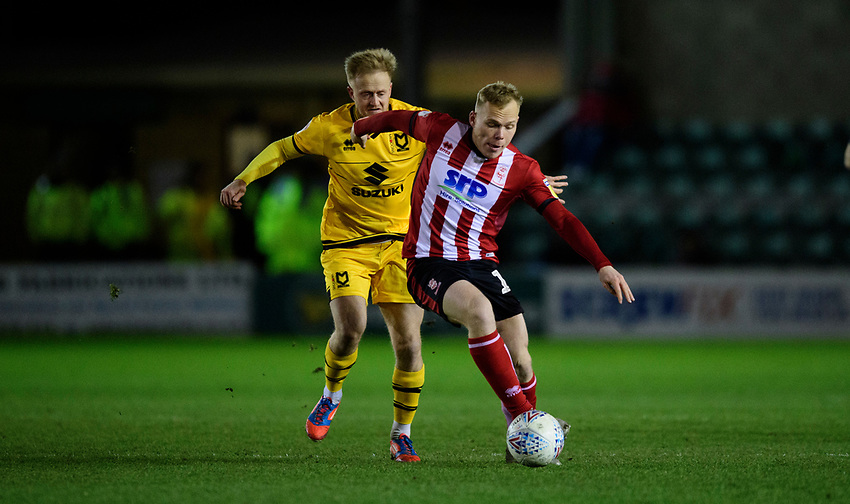 Lincoln City's Anthony Scully vies for possession with Milton Keynes Dons' Ben Reeves<br /> <br /> Photographer Chris Vaughan/CameraSport<br /> <br /> The EFL Sky Bet League One - Lincoln City v Milton Keynes Dons - Tuesday 11th February 2020 - LNER Stadium - Lincoln<br /> <br /> World Copyright © 2020 CameraSport. All rights reserved. 43 Linden Ave. Countesthorpe. Leicester. England. LE8 5PG - Tel: +44 (0) 116 277 4147 - admin@camerasport.com - www.camerasport.com
