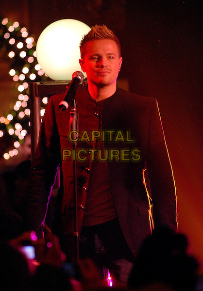 "WESTLIFE - NICKY BYRNE.At Harrods to promote their 9th album ""Back Home"" with signing and performance, London, England..November 5th, 2007.half length black jacket stage concert live gig performance music.CAP/FIN.©Steve Finn/Capital Pictures."